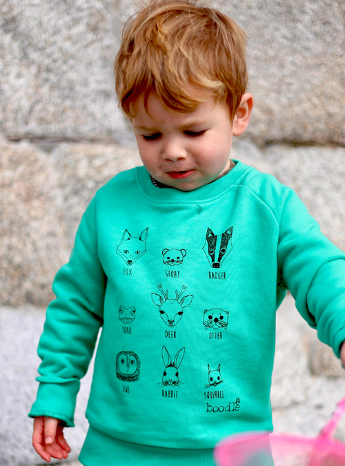 Kids animal faces sweater on beach