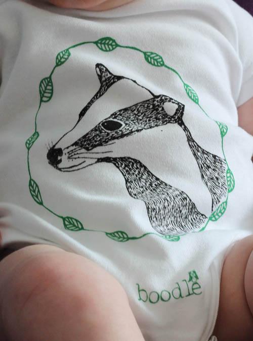 cute badger baby grow close up