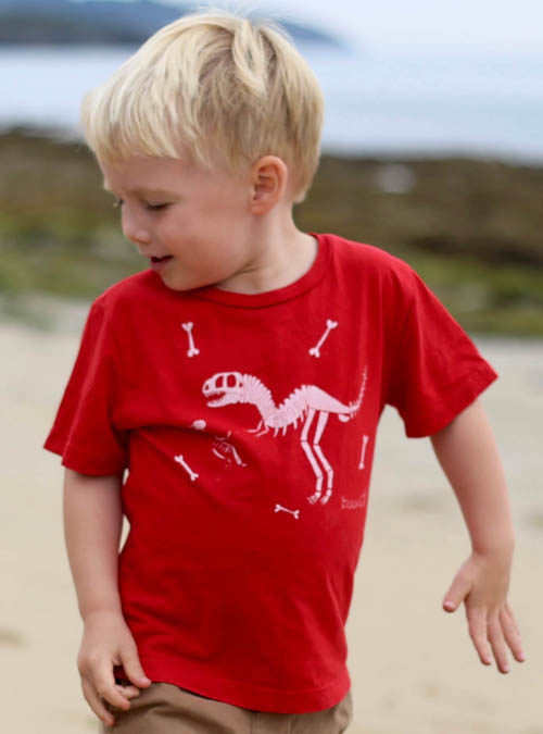 Kids dino T-shirt on the beach