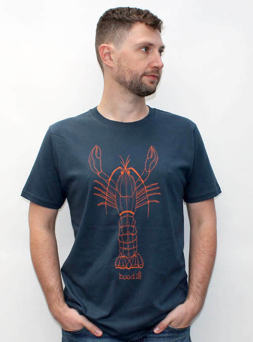Lobster Mens T-shirt against a white wall.